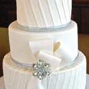 130x130 sq 1421263352929 winter wedding cake diagonal pleats with bow