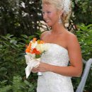 Our beautiful bride in our tropical garden with a tropical flower bouquet.