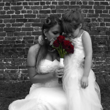 220x220 sq 1455404731044 bride flower girl smell red roses wedding