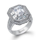 Style MR2218  18K white gold ring comprised of 0.80ctw round white diamonds and 1.65ctw baguette diamonds.