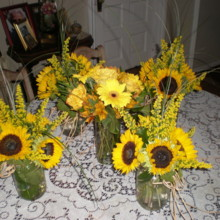 220x220 sq 1400162763367 gerberas and sunflower