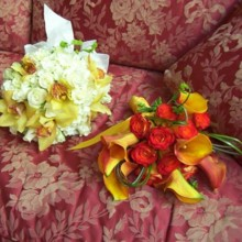 220x220 sq 1424805450396 oranged bridal bouquet with circus roses and mango