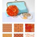 130x130 sq 1341286487239 orangeandblueandfabrics