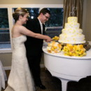 Brides love displaying their cakes on our white Baby Grand!