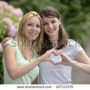 130x130 sq 1422045608829 stock photo lesbian couple forming heart shape wit