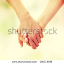 130x130 sq 1422046042527 stock photo two woman holding their hands 17601379