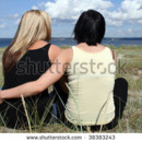 130x130 sq 1422046044557 stock photo two young women sitting at the beach h