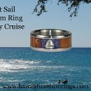 Hawaii Titanium Ring's original Night Sail Titanium Ring with Koa Wood, Lightning Ridge Opal, 14k Gold moon sliver, and a Silver sailboat image.