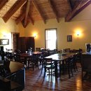 130x130 sq 1340904660177 diningroom