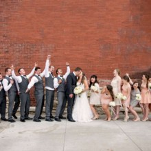 220x220 sq 1430936630444 fun bridal party cheers on bride and groom in city
