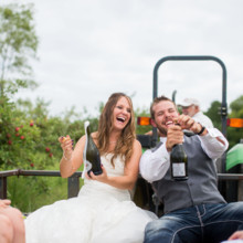 220x220 sq 1430936825918 bride and groom popping champagne