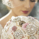 Champagne Ivory and pink brooch bridal bouquet with vintage brooches. Photography by Maegan Hay of maeganhayimaging.com Bouquet by Elegance On The Avenue