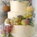 130x130 sq 1365609601651 buttercream wedding cake with frosted fall fruit