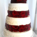 130x130 sq 1374606886968 fondant wedding cake with brocade lace and floating tiers