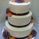 130x130 sq 1384181753357 buttercream wedding cake with purple modeling choc