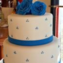 130x130 sq 1396797847607 white fondant wedding cake with royal blue gumpast