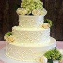 130x130 sq 1404062159336 buttercream wedding cake with scrollwork and green