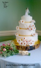 220x220 1375821830535 fondant wedding cake with monogram and white roses with gold and pink centers