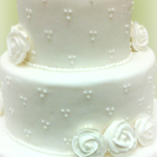 220x220 sq 1365110694707 white fondant triple dot wedding cake with royal icing roses