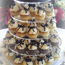 220x220 sq 1365609616518 cupcake wedding cake with black bows