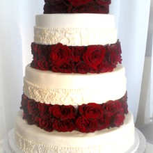 220x220 sq 1374606886968 fondant wedding cake with brocade lace and floating tiers