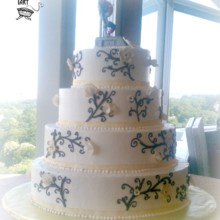 220x220 sq 1375820373455 buttercream wedding cake with black scrollwork and gold flowers
