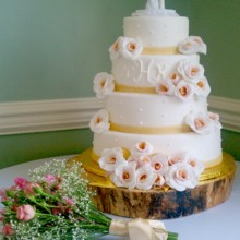 220x220 sq 1375820430589 fondant wedding cake with monogram and white roses with gold and pink centers