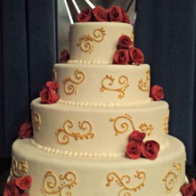 220x220 sq 1391456150936 gold scrollwork wedding cake with red rose