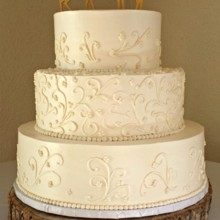 220x220 sq 1396797823910 buttercream cake with scrollwork and deer toppe