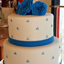 220x220 sq 1396797847607 white fondant wedding cake with royal blue gumpast