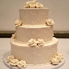 220x220 sq 1404062097144 buttercream wedding cake with dots and white roses