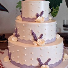220x220 sq 1404062142429 buttercream wedding cake with purple lace ribbon p