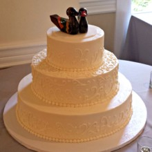 220x220 sq 1404062170817 buttercream wedding cake with scrollwork and korea
