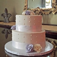 220x220 sq 1404062180165 buttercream wedding cake with white ribbon dots an