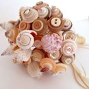 Shell button bouquet for the beach lovers! Replete with real shells and shell buttons, ribbon and finished with twine.
