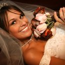 130x130 sq 1345490846373 bridelayingdownmedium