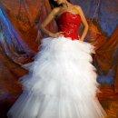130x130 sq 1345491635259 bridewithredtop