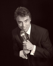 220x220 1374536964338 pic dl music standing holding mic sepia