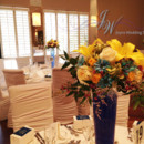 130x130 sq 1431625079669 yellow and blue centerpieces 1