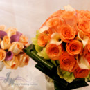 130x130 sq 1431628890981 coral roses with peach calla lilies 4