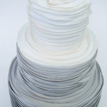 220x220 sq 1481306343433 gray ombre rose pleat wedding cake