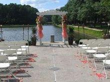 220x220 1483634505 034588c0ac46fa43 1432238959048 ceremony with peach colors
