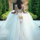 130x130 sq 1398044304806 bride walking towards main entrance back vie