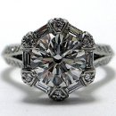 130x130 sq 1338909556442 antiqueengagementringknifeedgesplitshankroundcutemeralddiamonddesignerhalo