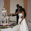 130x130 sq 1335274019938 cakecutting