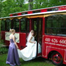 130x130 sq 1389722177886 trolley.bride stepping onto w.bridesmaid