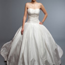 Daniela  Silk Tissue Taffeta.  Full Ball Gown.  Strapless pleated dropped waist bodice, with box pleat skirt and cathedral length train.  Gown accented with hand beaded crystal applique at the empire line.