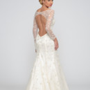 Eleina  Silk charmeuse. Floral sequin embellished tulle. Sheath gown with illusion sweetheart neckline and long sleeves. Key hole accentuates the back and godet sweep train completes the look of the gown