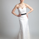 Elizabeth  Re-Embroidered lace. Sheath gown with satin under lay and scalloped lace hem line. Strapless sweetheart neckline with a detachable satin and lace train.