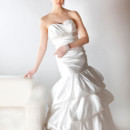 Mimi  Satin. Fit and flair pick up bubble ball gown. Strapless sweetheart neckline, and asymmetrical seam line at dropped waist. Accented with beaded empire line.